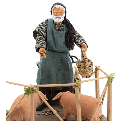 Animated Nativity scene figurine, man feeding pigs 14cm 2