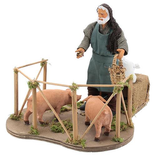 Animated Nativity scene figurine, man feeding pigs 14cm 3