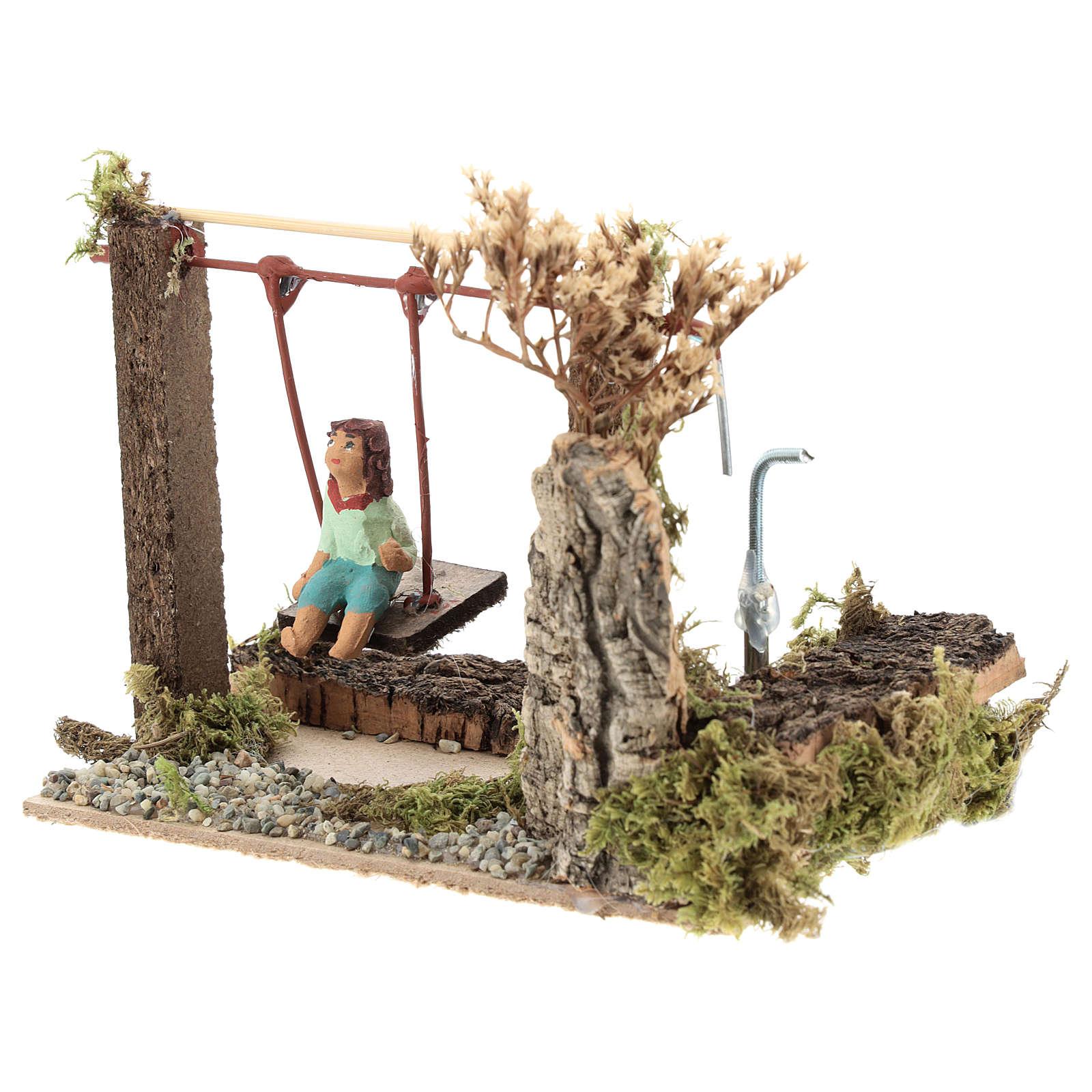 Child on swing, animated nativity figurine 10cm 3