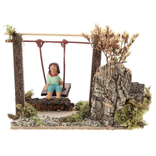 Child on swing, animated nativity figurine 10cm 1