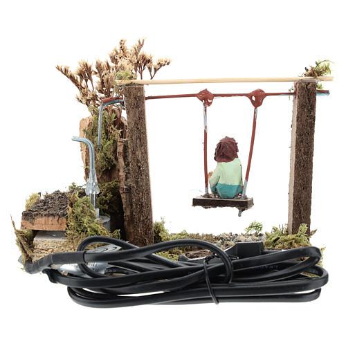 Child on swing, animated nativity figurine 10cm 4