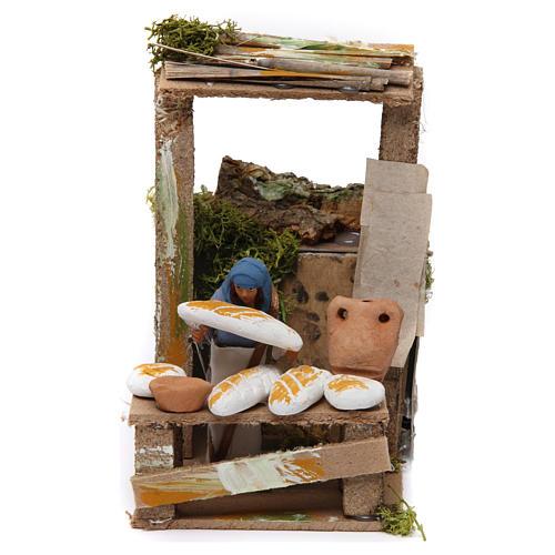Vendedor de pão movimento para presépio com figuras altura média 7 cm 1