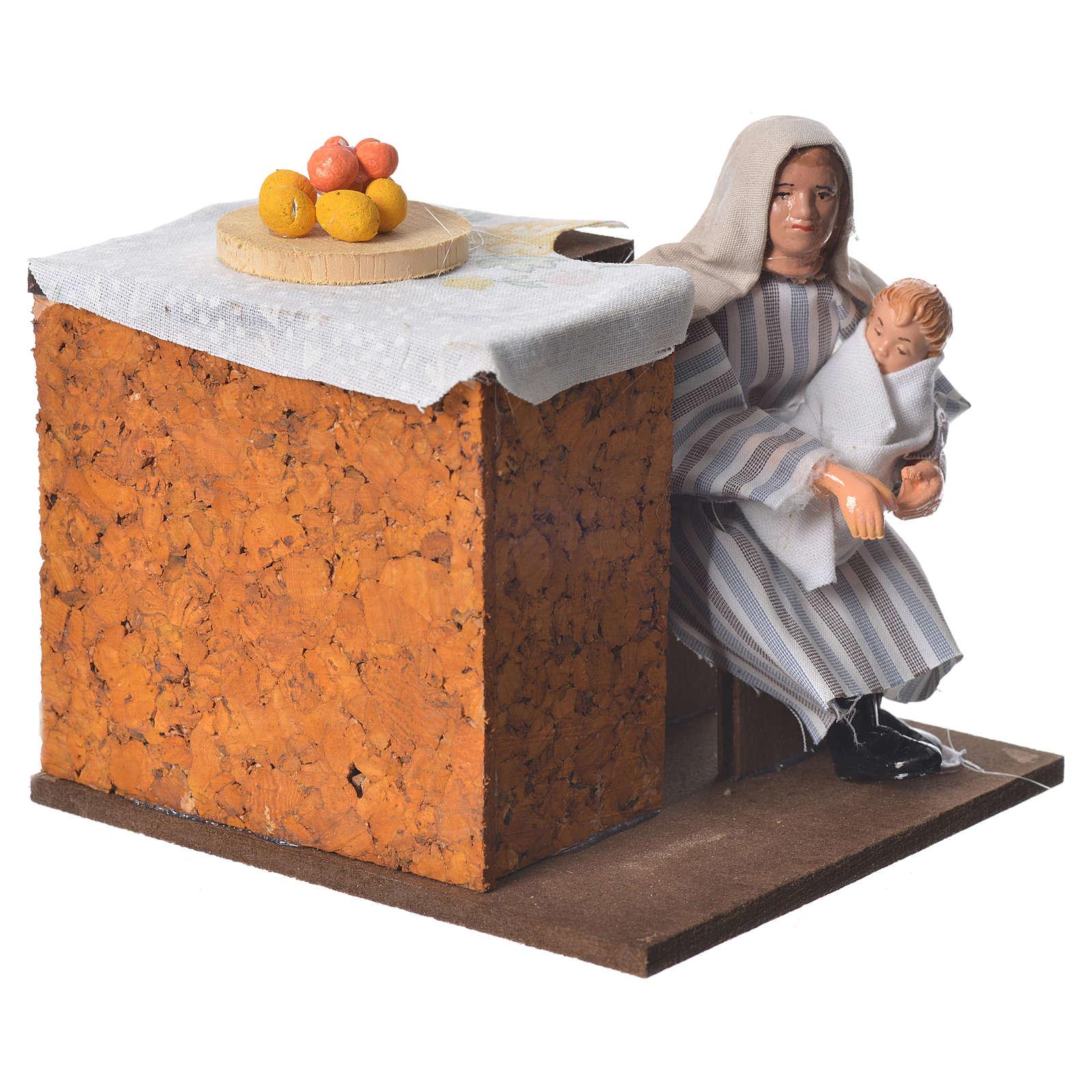 Arabian woman cradling child 12cm animated Nativity 3