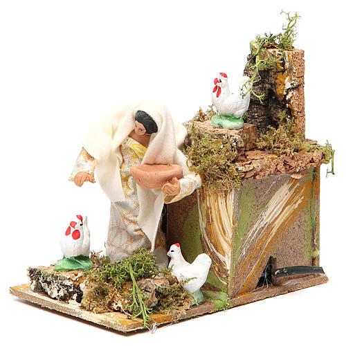 Animated nativity figurine 10cm farmer with hens 2