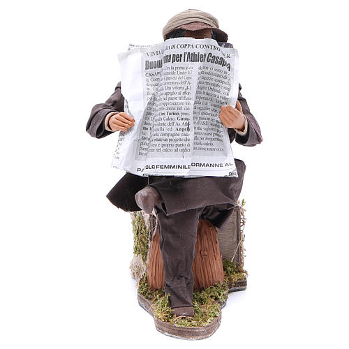 Man reading paper figurine for animated Neapolitan Nativity, 24cm 1