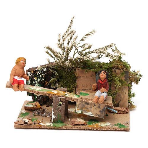 Boy and girl on seesaw measuring 7cm, animated nativity figurine 1