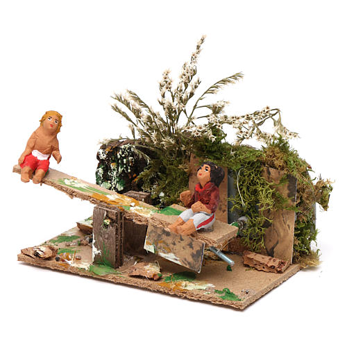 Boy and girl on seesaw measuring 7cm, animated nativity figurine 2