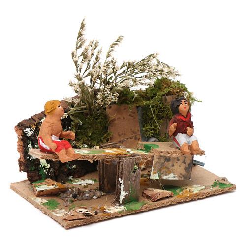 Boy and girl on seesaw measuring 7cm, animated nativity figurine 3