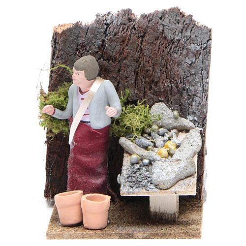 Man selling fish measuring 10cm, animated nativity figurine 1