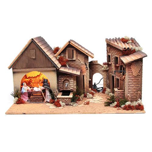 Pueblo con cabaña Belén natividad 12cm movimiento 30x60x35 cm 1