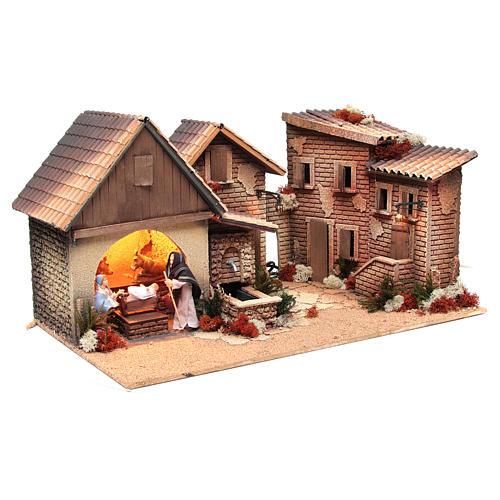Pueblo con cabaña Belén natividad 12cm movimiento 30x60x35 cm 3