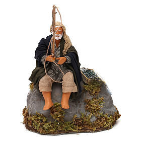 Man fishing from rock a 12cm Neapolitan Nativity animated figurine s1