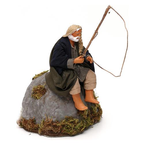 Man fishing from rock a 12cm Neapolitan Nativity animated figurine 3