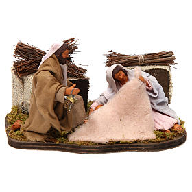Belén napolitano: Natividad sentada 12 cm con movimiento belén napolitano