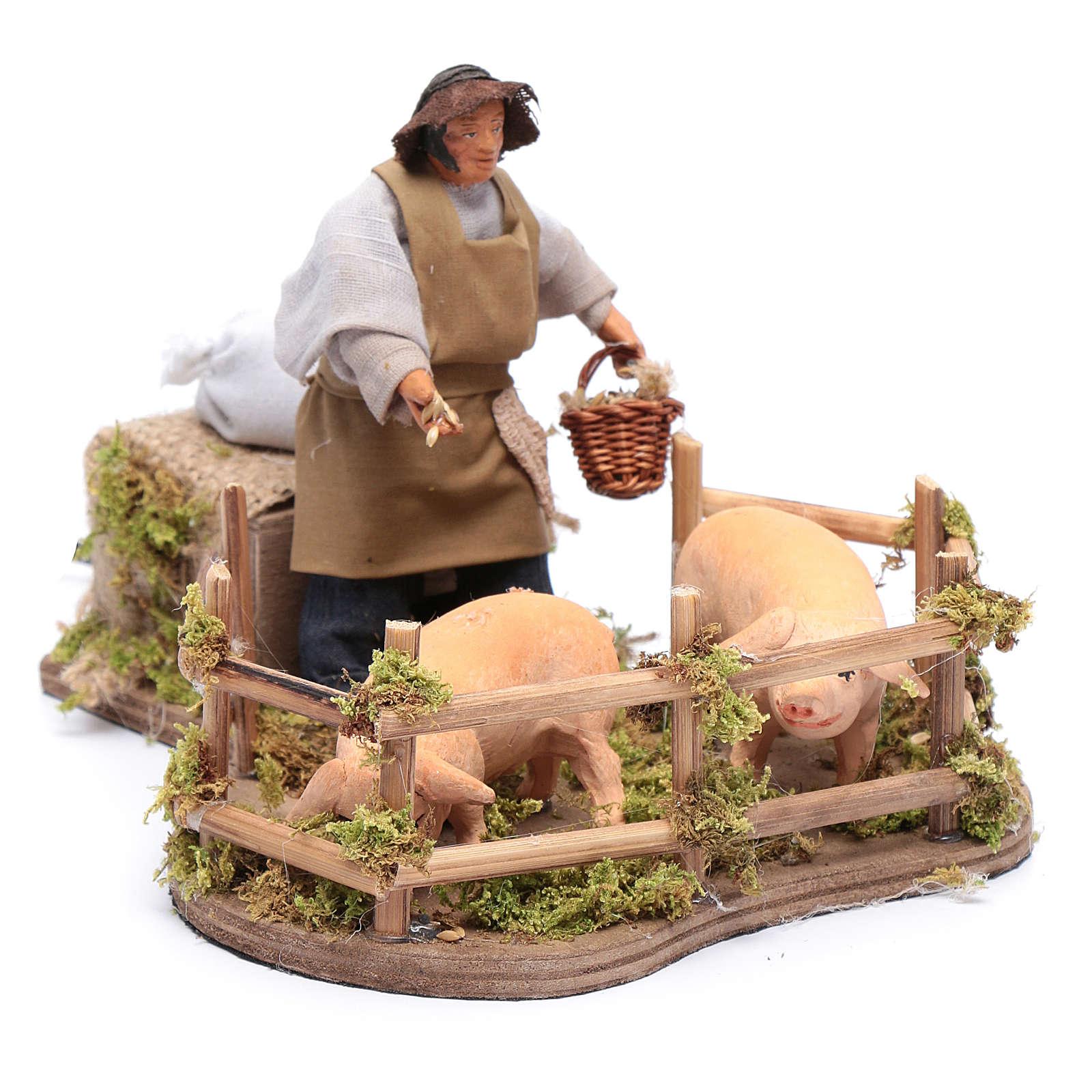 Movimento uomo che dà da mangiare ai maiali 12 cm 4