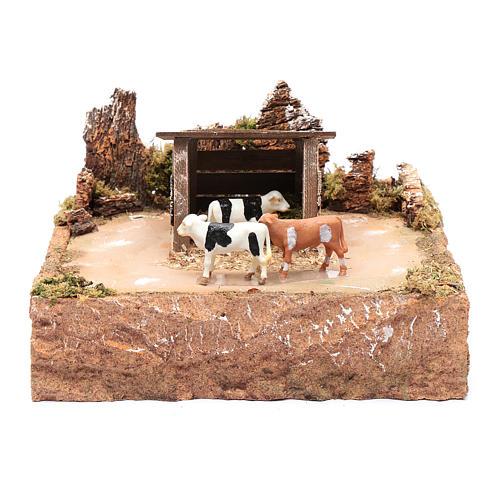 Mucche in movimento con paesaggio 15x25x25 cm 1