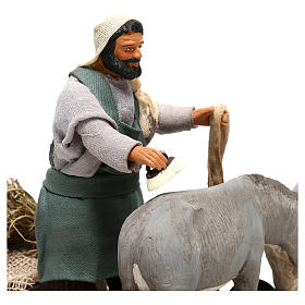 Man currying donkey  in movement 14 cm for Neapolitan nativity scene s2