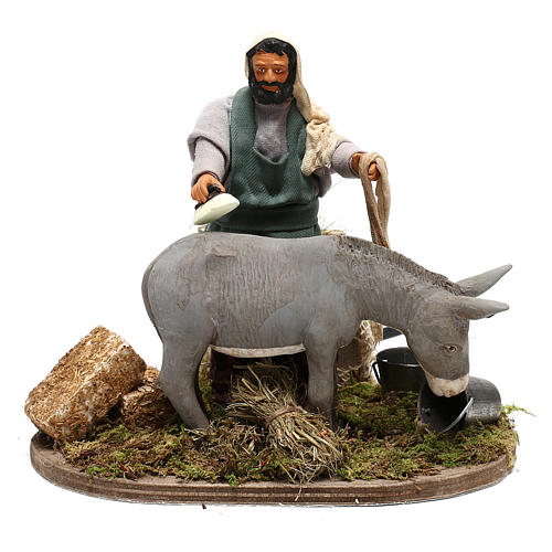 Man currying donkey  in movement 14 cm for Neapolitan nativity scene 1