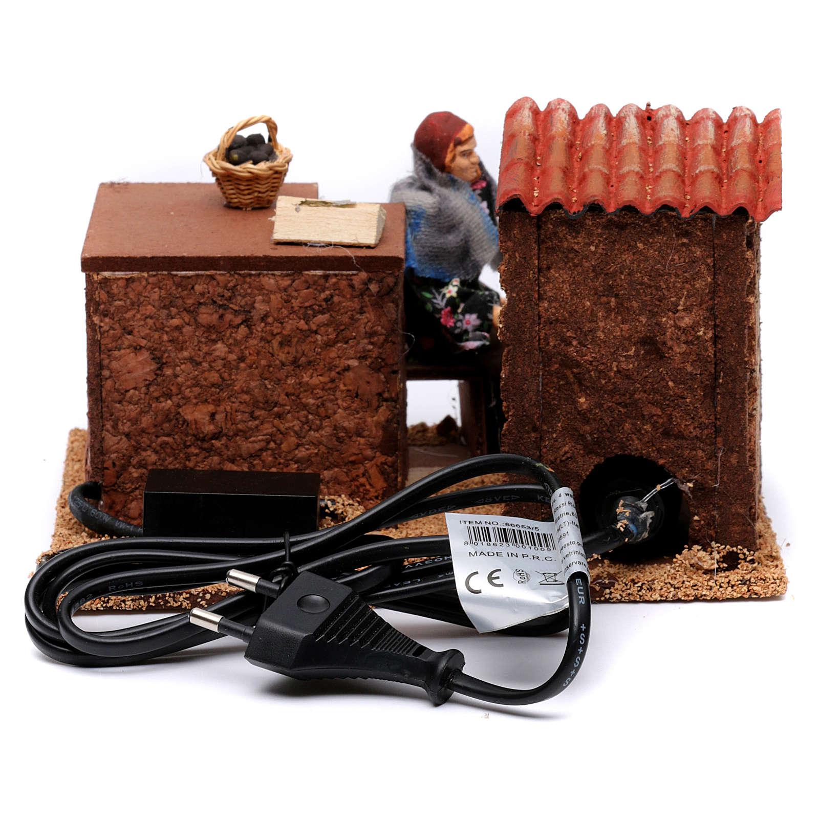 Venditrice di caldarroste movimento per presepe 12 cm 3