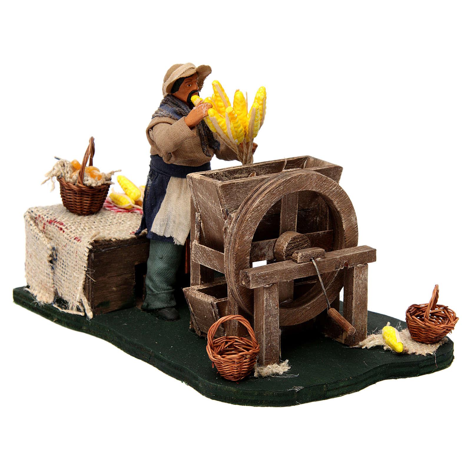 Homme qui égraine des épis de maïs en mouvement pour crèche napolitaine de 12 cm 4