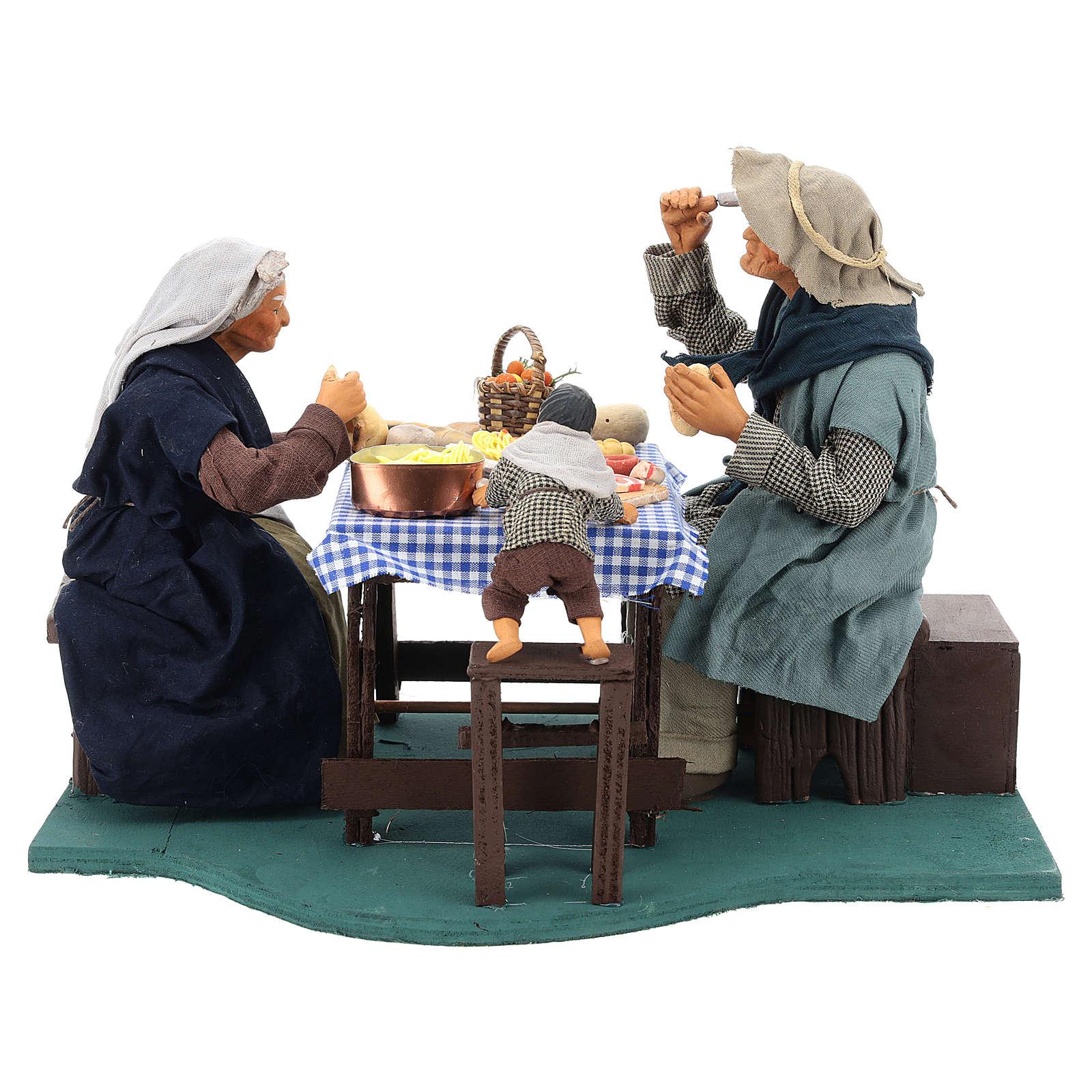 Escena familia que cena con niño 24 cm de altura media belén Nápoles 4