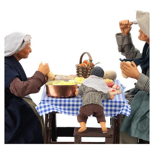 Escena familia que cena con niño 24 cm de altura media belén Nápoles 7
