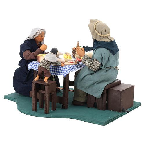 Escena familia que cena con niño 24 cm de altura media belén Nápoles 8