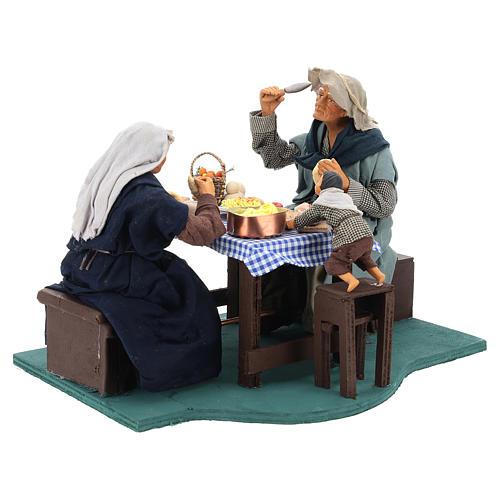 Escena familia que cena con niño 24 cm de altura media belén Nápoles 9