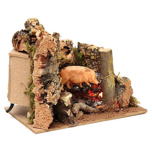 Escena cerdo en el asador con movimiento belén 11 cm 2