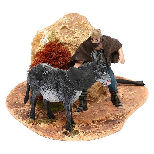 Hombre y burro Oliver con movimiento para belén 10 cm 1