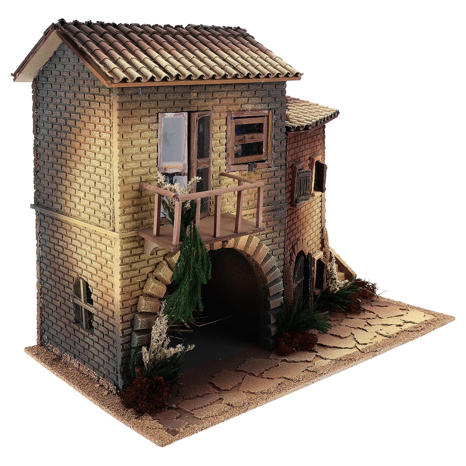 Casa con mujer que abre ventana 45x50x30 cm movimiento belén 12 cm 3