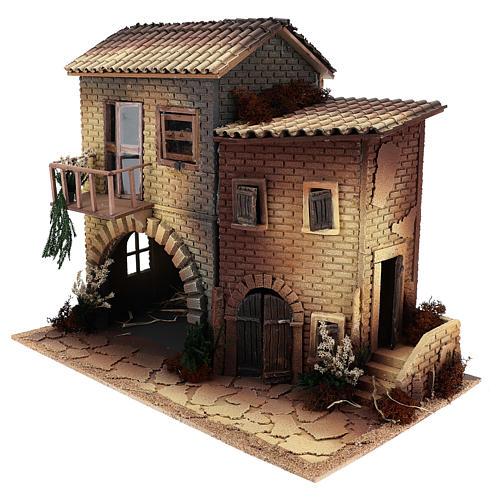 Casa con mujer que abre ventana 45x50x30 cm movimiento belén 12 cm 2