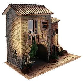 Maison avec femme qui ouvre la fenêtre 45x50x30 cm mouvement crèche 12 cm s3