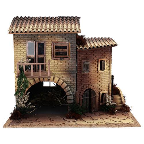 Maison avec femme qui ouvre la fenêtre 45x50x30 cm mouvement crèche 12 cm 1