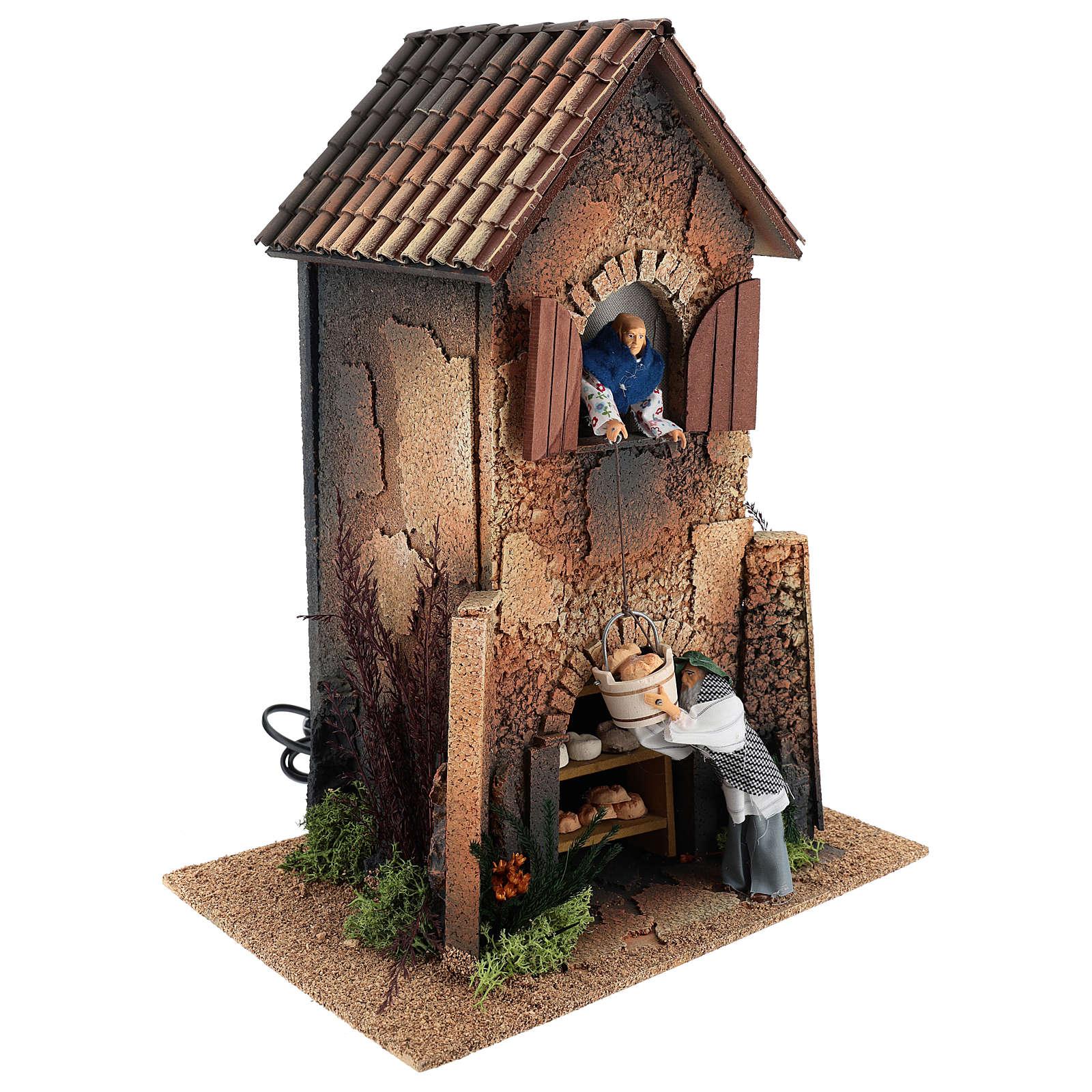 Maison femme qui descend un panier par la fenêtre 40x30x20 cm mouvement crèche 12 cm 3