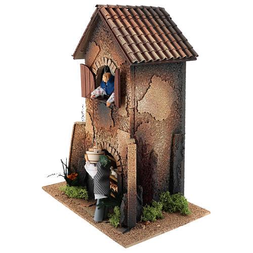 Maison femme qui descend un panier par la fenêtre 40x30x20 cm mouvement crèche 12 cm 2