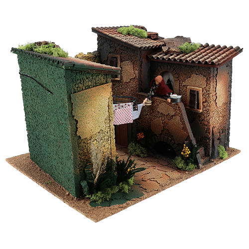 Village with woman hanging up the wash moving 30x45x35 cm, 12 cm nativity 3