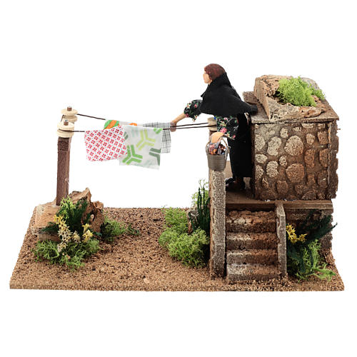 Woman hanging the wash, 12 cm moving nativity 1