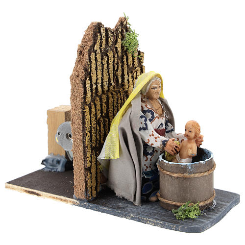 Moving woman washing baby for Neapolitan Nativity Scene 7 cm 3