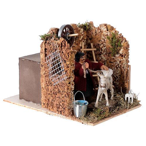 Moving figurine for Neapolitan Nativity scene, man currying donkey 8 cm 3