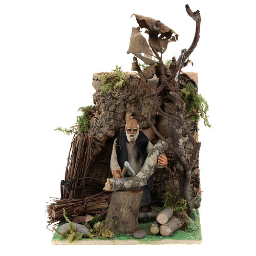 Man cuts wood for Neapolitan Nativity scene of 8 cm 1