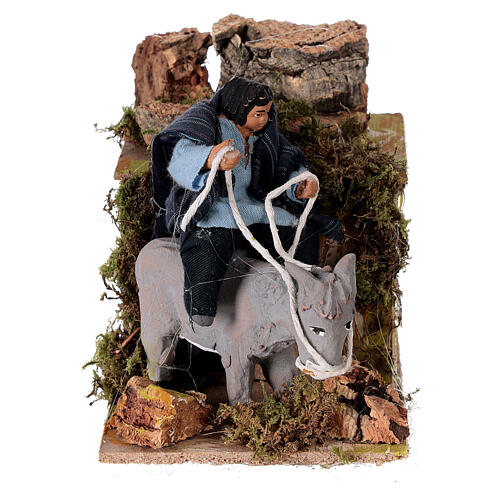 Boy riding a donkey, animated nativity figure 10 cm 1
