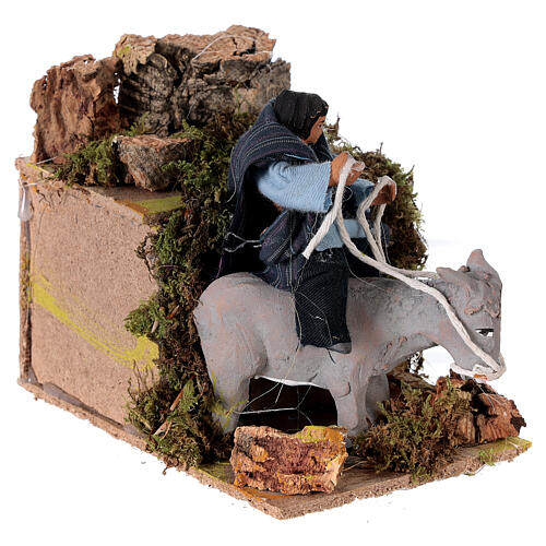 Boy riding a donkey, animated nativity figure 10 cm 3