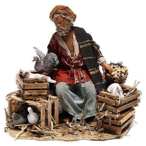 Sitting man with doves 13cm, Nativity Scene by Angela Tripi 1