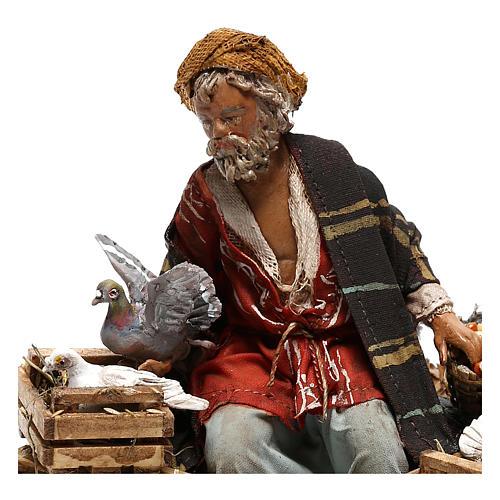 Sitting man with doves 13cm, Nativity Scene by Angela Tripi 2