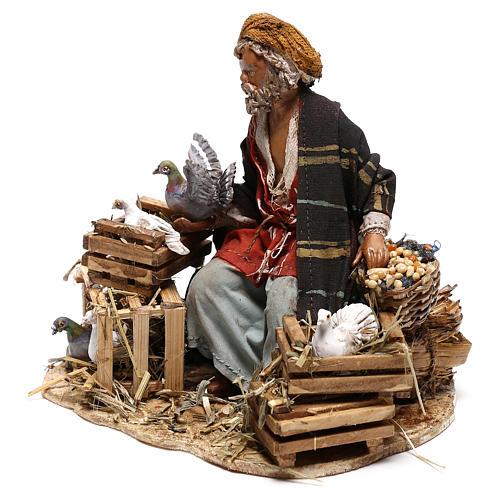 Sitting man with doves 13cm, Nativity Scene by Angela Tripi 3