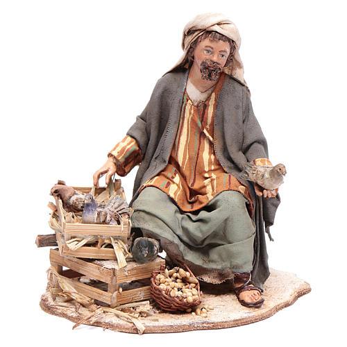 Pastore seduto con colombe 13 cm presepe Angela Tripi 1