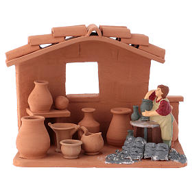 Man with lathe in Deruta terracotta handmade for Nativity scenes of 10 cm s1