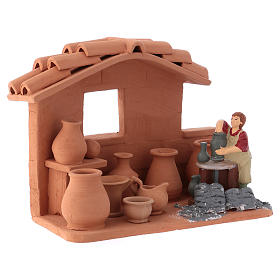 Man with lathe in Deruta terracotta handmade for Nativity scenes of 10 cm s2
