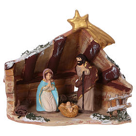 Coloured terracotta hut with 6 cm Nativity scene and comet made in Deruta s1
